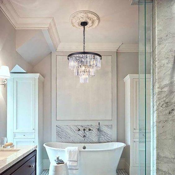 modern chandelier over bathtub