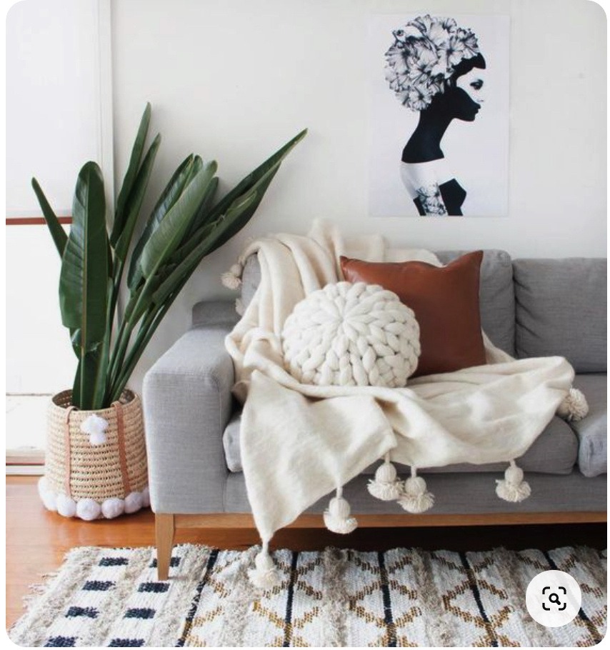 how to arrange throws and cushions on a sofa